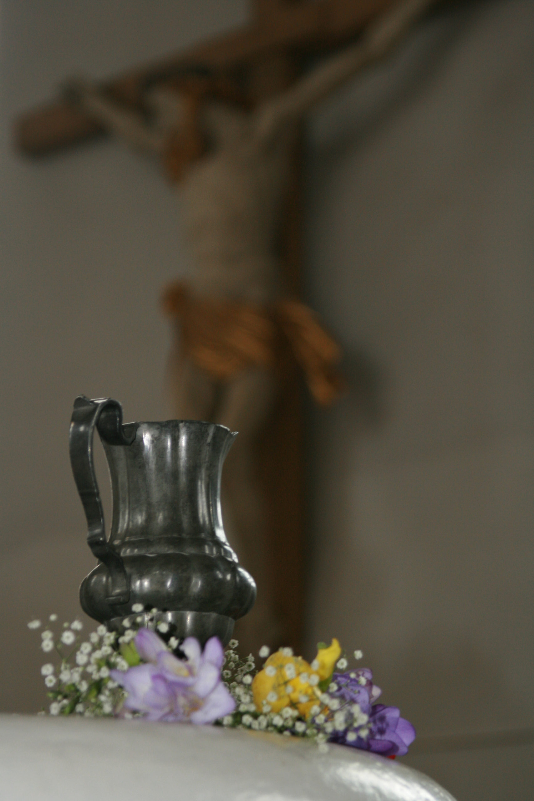 baptism-stone with flowers and water cup - in the background the jesus - vision? Uploaded byforst747 sxc hu